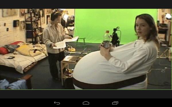 Cute girl cosplays as very pregnant Padame using huge balloon